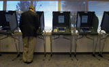 (Littleton., on Sun. Oct. 21 2004) Colorado Gov. Bill Owens votes early at the Arapahoe County,...