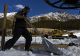 (Arapahoe Basin., on 10/21/2004)-First-year Arapahoe Basin ski area lift operator Ryan PetitBon...