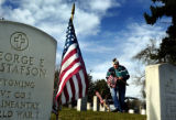 11/05/2004 Denver, Colorado-Korean War Veteran Bob Weyand of VFW Post 2461 place flags on the...