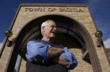 (Paonia, Colo, October 20, 2004) Robert Johnson,standing in front of the Paonia town hall, is a...