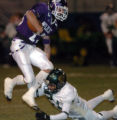 (ARVADA, CO., NOVEMBER 5, 2004) Arvada West's #13, Tyler Loomis, left, trys to get past Bear...