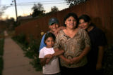 (10/21/2004) Denver, Colorado-Carmen Rocha, Denver, with her children Isabel, from left, Diego and...