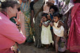 (1/17/05,Kaalapet, India)   Teri Lynn greets children and their mothers as she heads to the...