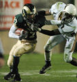 (LAKEWOOD, CO., OCTOBER 22, 2004)  Colorado State' #87, Damon Morton, left, stiff arm Wyoming's  #...