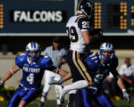 Wide receiver Chris Hale of BYU hauls in a pass against Air Force defenders Julian Madrid, left,...