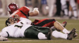 SLCU106 - Colorado State kicker Jeff Babcock lies stunned after being roughed by Utah linebacker...