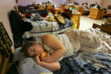 A women (who refused to be identified) sleeps with a teddy bear at the Women In Change Safe Haven...