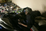 (Philadelphia, PA, April 7, 2005) John, a homeless man, sleeps amid piles of trash underneath the...