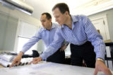 Exclusive Resorts President Brent Handler (left) looks over plans for a new home near Puerto...
