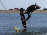 (CHERRY CREEK RESERVOIR, Colo., April 14, 2005) Alex Oblas (cq) releases the tow rope in the...