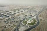04/15/2005 Iraq-Traffic backs up around a traffic circle on MSR Tampa in south Baghdad on Friday,...