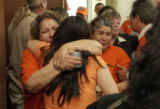 Two unidentified women hug at the Adams County Courthouse in Brighton, Colo., after the sentencing...