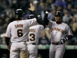 (DENVER, CO Shot on 4/15/05) The San Francisco Giants' Pedro Feliz (far right) high fives...