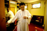 (WHEAT RIDGE, Colo., April 17,2005) Rev. Khanh Nguyen (cq) gets ready for the noon service of his...