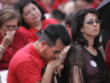 (DENVER, Colo., April 17, 2005) Jorge Torres (center) listens to a moving tribute to his...