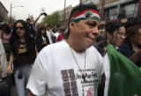 (DENVER, Colo., April 17, 2005) Tony Gonzales (rt) from Northglenn, CO. marches with thousands...
