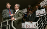 Denver Mayor John Hickenlooper, right, thanks David Kenney (cq), campaign director among other...