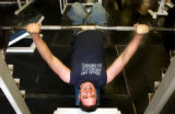 (Vernal, Utah) Jonathan Swain, 21, bench presses at his gym in Vernal, Utah. Jonathan works out as...