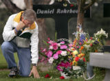 (Centennial, Colo., April 14, 2005) Darrell Scott touches the grave stone of his daughter, Rachel...