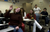 (CENTENNIAL, Colo., January 5, 2005) Megan Vulasovich, foreground, left of frame, brown sweater,...
