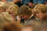(CASTLE ROCK, Colo., Apr. 20, 2005)  Unidentified mourners wipe away tears during a memorial...