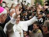 Pope Benedict XVI greets the crowd outside his residence in the Vatican, April 20, 2005. The pope...