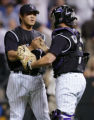 DXF106 - Colorado Rockies relief pitcher Chin-hui Tsao, left, of Taiwan, is congratulated by...