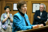 Former State Senator Polly Baca (center) of Denver leads a discussion during a press conference as...
