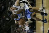 Denver Nuggets Earl Boykins against the San Antonio Spurs in the second half of Game 1 of their ...
