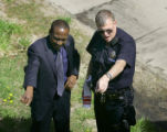 Denver Police Department technician Joseph Huebner (right) points to the spot where he recovered...