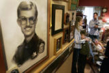 A photo of Sgt. Tim Mossbrucker hangs in his families home 10 years after his death. Lynn...