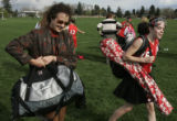 Anne Castle, left, an attorney with Holland & Hart,  helps her daughter Beth Daviess, 13, with...