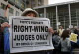 Sharon Shaffer, Parker, holds a sign at a rally outside the Alfred A. Arraj U.S. Courthouse in...