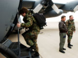 (COLORADO SPRINGS, Colo., Jan. 4, 2005) Staff Sgt. Peggy Logan boards a C-130 after saying her...