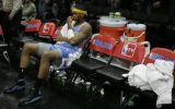 Denver Nuggets Carmelo Anthony sits alone on the bench after his teammates left for the locker...