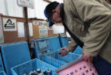 (NYT72) KAMIKATSU, Japan -- May 11, 2005 -- JAPAN-RECYCLE -- Masaharu Tokimoto tries to determine...
