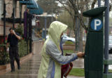 Beth Lindsay (cq) from Evergreen, Colorado puts money in a parking kiosk in Cherry Creek North...