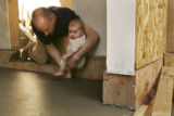 HGTV Dream House project.   Christopher Herr (cq) places his daughter Talia's foot into concrete...