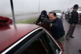 (L-R Jesus Alverado (cq) and Manuel Alvarado (cq) try to open their trunk after being  involved in...