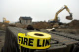 A roll of unused fire line tape sits on top of a pallet of tiles at 5301 Moonlight Way in the...