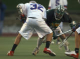 Denver, Colo., photo taken April 29, 2005- Cherry Creek's, Dane Mueller (cq #32 LEFT) faces off...