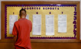 Denver North High School sophomore Aron Palma (cq), 17, looks over his grade in teacher Lawrence...