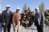 Jack Hallowell, Chan Rogers and Carl Getzel pose with the wreath they dedicated to the...