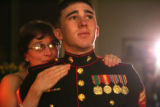 Jo Burns (cq), left, Laramie, Wyoming, comforts Corporal Dustin Barker (cq), 22, during a ceremony...