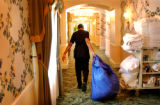 Broadmoor Hotel Housekeeper Judith Kenton (cq), 29, removes soiled bedding from one of the hotels...