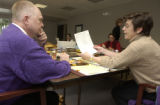 Tom Hanson,(LEFT) purple sweater, bald, teacher, works on the vote count with Diane Waco,(RIGHT)...