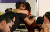 (Center Lt. to Rt.) Joseph Gallegos (cq), 17, hugs friend Concepcion Rodriguez (cq), 17, after...