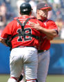 AXL105 - Atlanta Braves pitcher Mike Hampton, right, hugs catcher Eddie Perez after a two-hit...