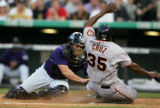 DXF106 - Colorado Rockies catcher J.D. Closser, left, applies the tag to San Francisco Giants'...