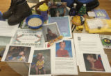 A memory table set up by the family in their home kitchen displaying some favorite items.  Evan...